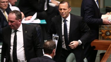 A wink from Prime Minister Tony Abbott in the direction of Environment Minister Greg Hunt at Parliament House.