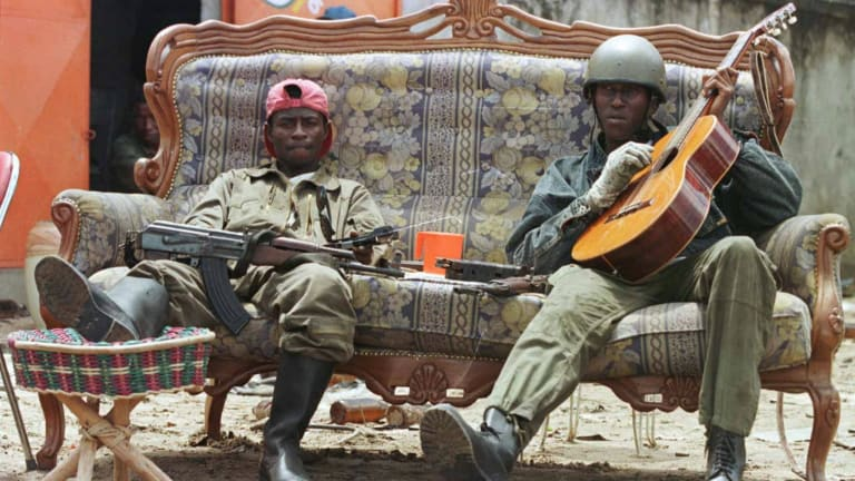 """""""Cobra"""" rebels loyal to Denis Sassou Ngouesso man a roadblock on a street in Brazzaville, Congo in 1997."""