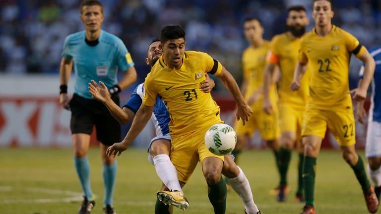 Australia's Massimo Luongofights for the ball with Honduras' Alfredo Mejia.