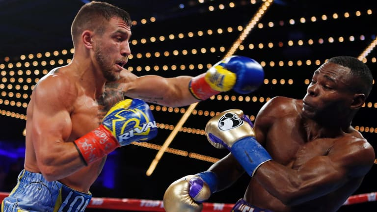 Vasyl Lomachenko punches Guillermo Rigondeaux during the third round of their bout in New York.