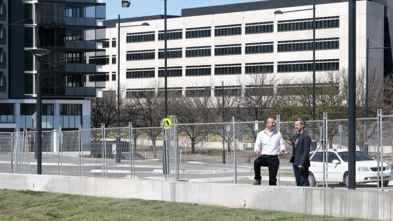 Chief Minister Andrew Barr and SHL Development CEO Terry Shaw look at the landscaping work at the Campbell 5 development opposite the ASIO headquarters.