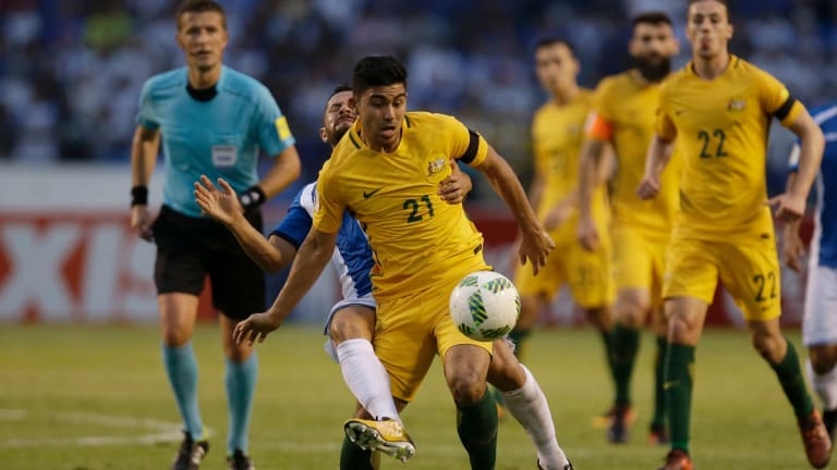 Australia's Massimo Luongofights for the ball with Honduras' Alfredo Mejia.
