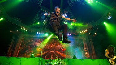 Bruce Dickinson, in full flight, in concert with Iron Maiden.