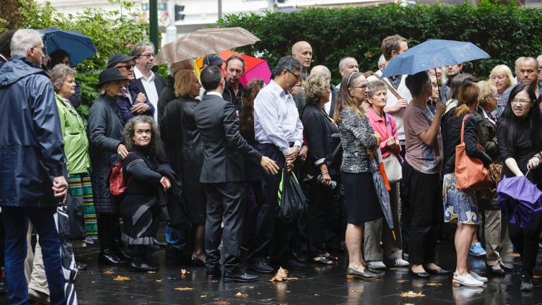Crowds gather at the memorial service for Bill Leak at Sydney Town Hall.