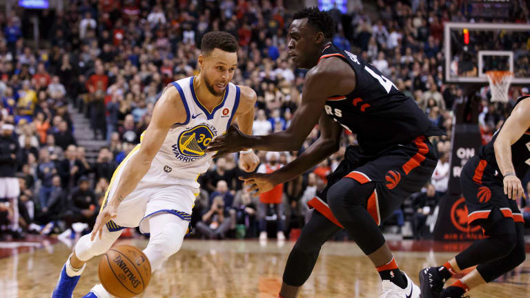 Stephen Curry drives to the basket against Toronto Raptors forward Pascal Siakam.