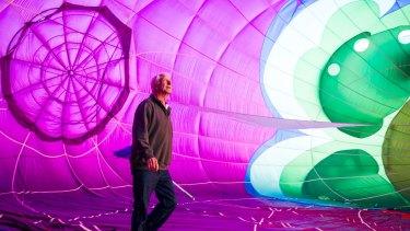 Canberra Balloon Festival 2018. Hot air balloon pilot Doug Grimes prepares the hummingbird hot air balloon for lift off.