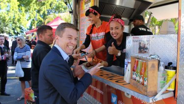 Brisbane councillor Julian Simmonds tries out the King of the Wings.