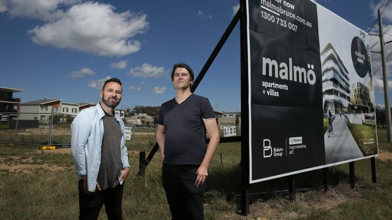 From left, developer/creative director Nik Bulum and architect Nathan Judd in front of the site of the future Malmo apartment and commercial development near the intersection of Ginninderra Drive and Braybrooke Street in Bruce.