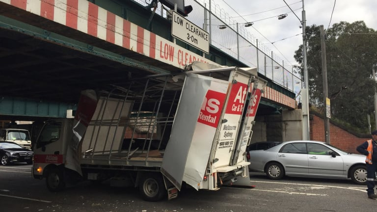 A rental truck wedged itself under Montague Street bridge on Friday afternoon.