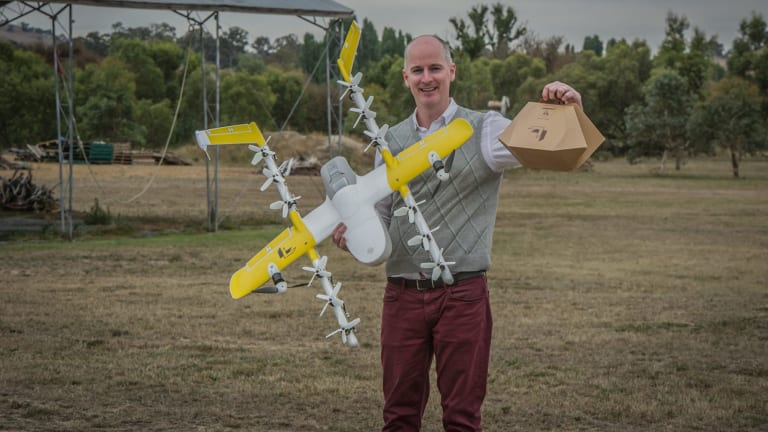 Project Wing has been developing a drone delivery service for Tuggeranong, delivering hot meals and chemist supplies. Delivery project manager Luke Barrington takes delivery of a hot lunch from Guzman Y Gomez.