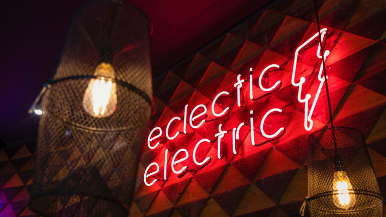 Flashing red neon makes it impossible to miss the hyper-hip eatery.