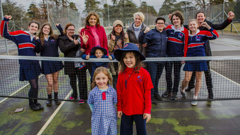 Telopea Park School PNC members and students celebrating. Front, from left, students Xanthe Merritt, 6, and Martin Millar, 7.