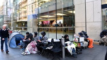 Tent city: iPhone fans (and those working as place holders) outside Apple's Sydney store in George St on Friday morning.