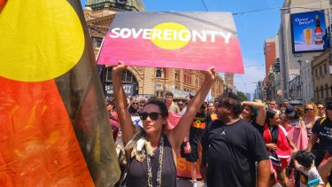 Aboriginal and pro-Aboriginal protestors march through Melbourne on January 26.
