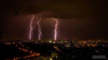 Lightning lights up the Brisbane CBD on Wednesday morning.