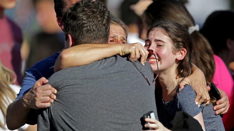 A family reunites following the shooting at Marjory Stoneman Douglas High School.