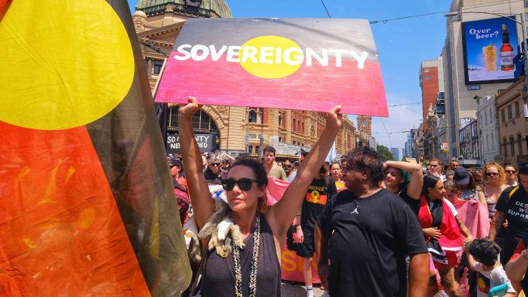 Aboriginal and pro-Aboriginal protestors march through Melbourne on January 26.