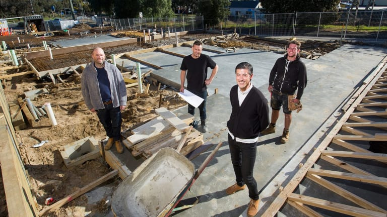 The model is a brainchild of Property Collectives founder Tim Riley, (second from right) with (from left) architect Lincoln Glover, builder Sean McKenzie and carpenter Lloyd Emery.