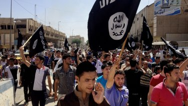 Demonstrators chant pro-Islamic State group slogans in Mosul, Iraq in 2014.