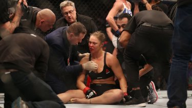Ronda Rousey receives medical treatment after her loss.