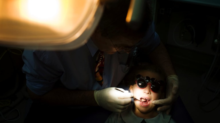 The government will reap $125 million with changes to the way dental health care for children is funded.