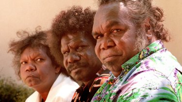 """""""They need one foot in both worlds"""": Aurukun Shire councillor Jonathon Korkaktain, centre, believes local boys like the ones above should be sent away to boarding school after they turn nine."""