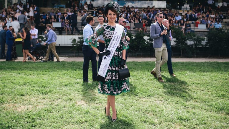 Fashions on the Field women's winner Kate Lynch from Hawksberry in Sydney, in the green and white floral dress her mother made.