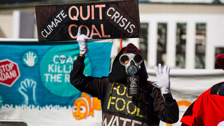 Protestors gather at Federal Parliament this week to oppose the Adani coal mine.