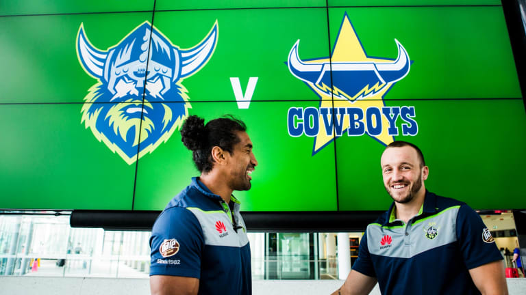 The Canberra Raiders players arive at the Canberra Airport, to go to Townsville for their opening round match against the Cowboys. Raiders player Sia Soliola and Josh Hodgson. Photo: Jamila Toderas