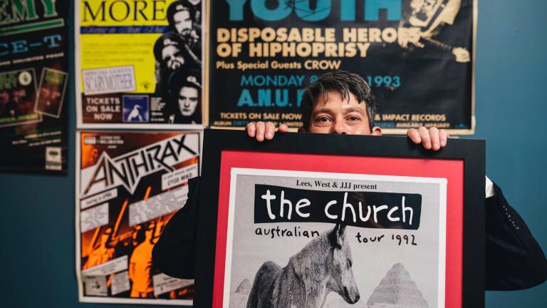 Peter Spicer at home with some of his ANU Refectory band memorabilia from the 1990s.