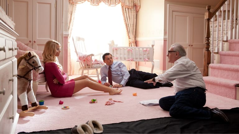Margot Robbie with Martin Scorsese  and Leonardo DiCaprio in <i>The Wolf of Wall Street</i>.