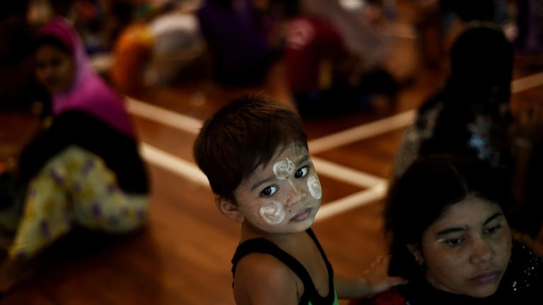 A Rohingya boy waits with other migrants at the temporary detention centre in Langkawi on Tuesday.