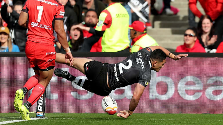 Touching down: Dallin Watene-Zelezniak dives over to score.