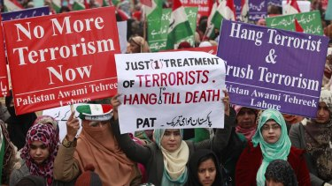 Protesters condemn the Taliban attack on the school in Peshawar.