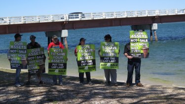 Protesters gather at the announcement of a second bridge to Bribie Island.