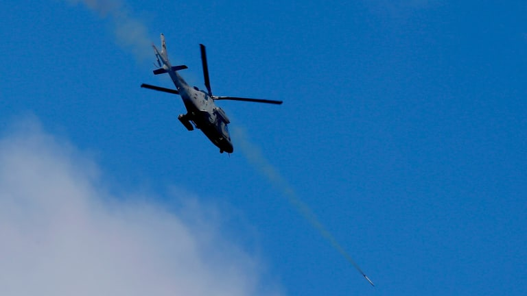 A helicopter gunship fires a rocket at Islamist militant positions in Marawi, a provincial capital on the southern Philippine island of Mindanao.
