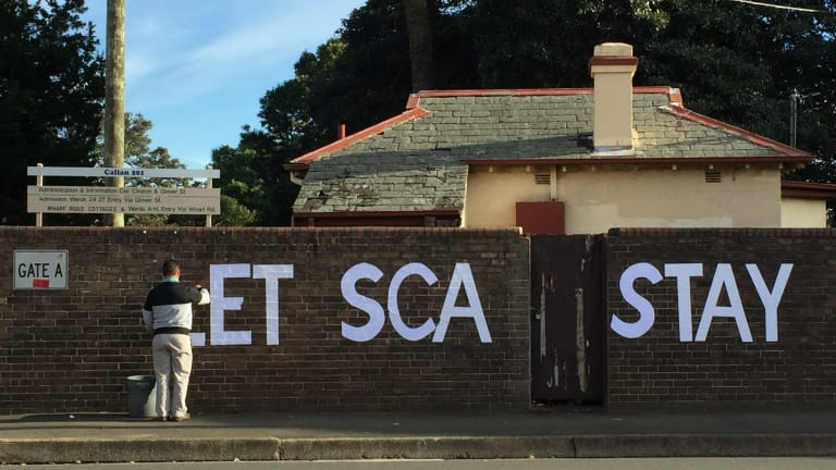 Protest graffiti outside the Sydney College of the Arts. SCA students are unhappy about the decision to close the arts school.