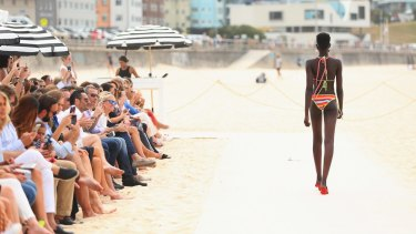 A model showcases designs during The Iconic Summer 2017 Swim Collection Fashion Show at Bondi Beach.