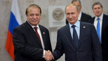 Russia's President Vladimir Putin (right) shakes hands with Pakistan's Prime Minister Nawaz Sharif during the Shanghai Co-operation Organisation (SCO) summit in Ufa, Russia, on Friday.