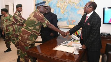 Zimbabwean President, Robert Mugabe, right, meets Defence Forces generals in Harare at State House on Sunday.