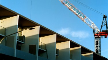 The central bank said the risks from apartment oversupply in some markets were starting to show.