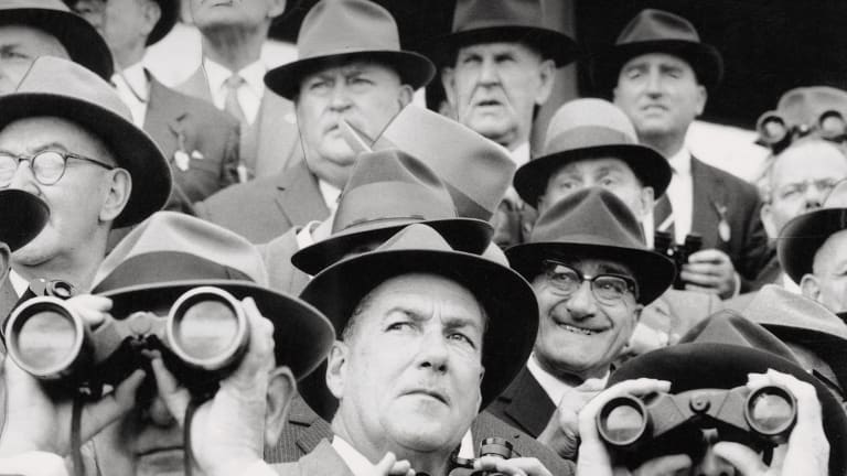 Different times: Men at the races in 1959.