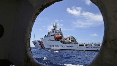 A Chinese Coast Guard ship attempts to block a Philippines government vessel in the South China Sea.