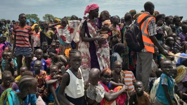 People in South Sudan line up to be registered with the UN World Food Program - some 23 million people were displaced by extreme weather events this past year.
