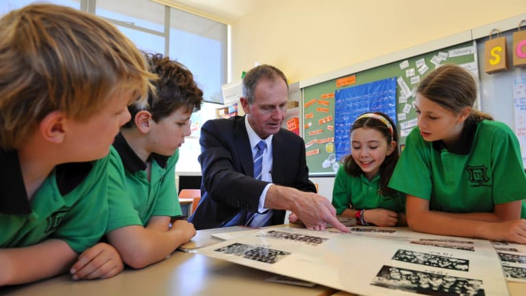 Philanthropist and entrepreneur Graham Tuckwell visits his old school, Turner Primary, and meets students Sebastian Conner, Jarrah Palethorpe, Bridget Darby and Jaiha Birkett last year.