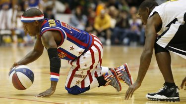 Little marvel: Too Tall Hall is the smallest player in Harlem Globetrotters history.