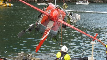The wreckage of the seaplane is lifted from the river on January 4.