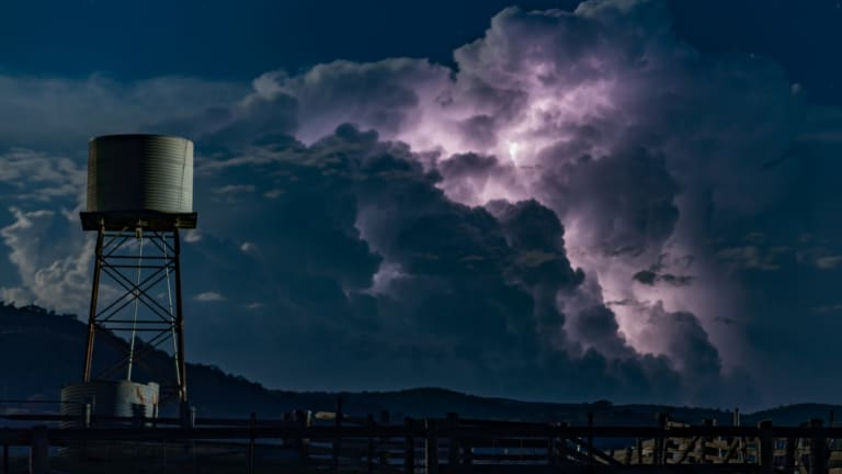 Canberra photographer, Ian Williams from Calwell, captured Tuesday's storm, lit up by a supermoon.
