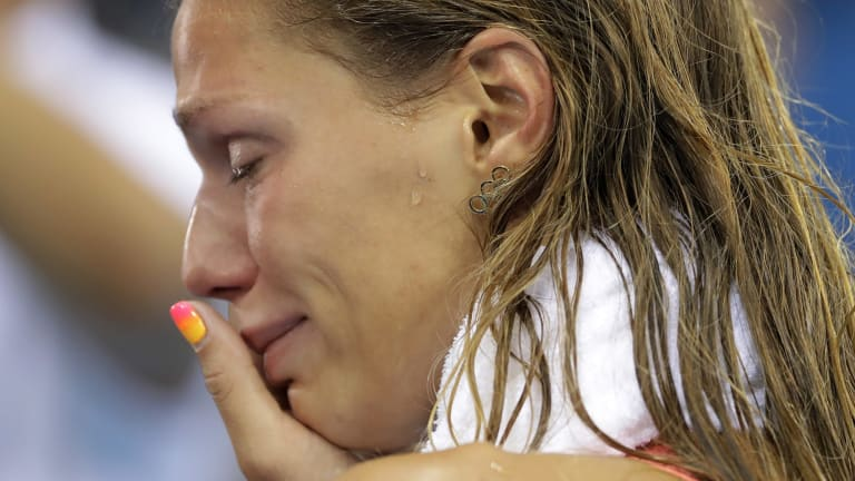 Russia's Yulia Efimova cries after placing second in the women's 100-meter breaststroke final.