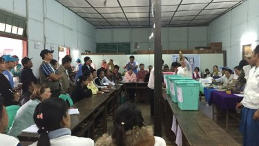 Scrutineer Jane Waddell (left) watches as the count begins in Kalaw, Myanmar.
